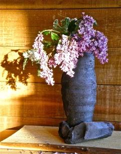 Ember encrusted unglazed stoneware vase with lilacs