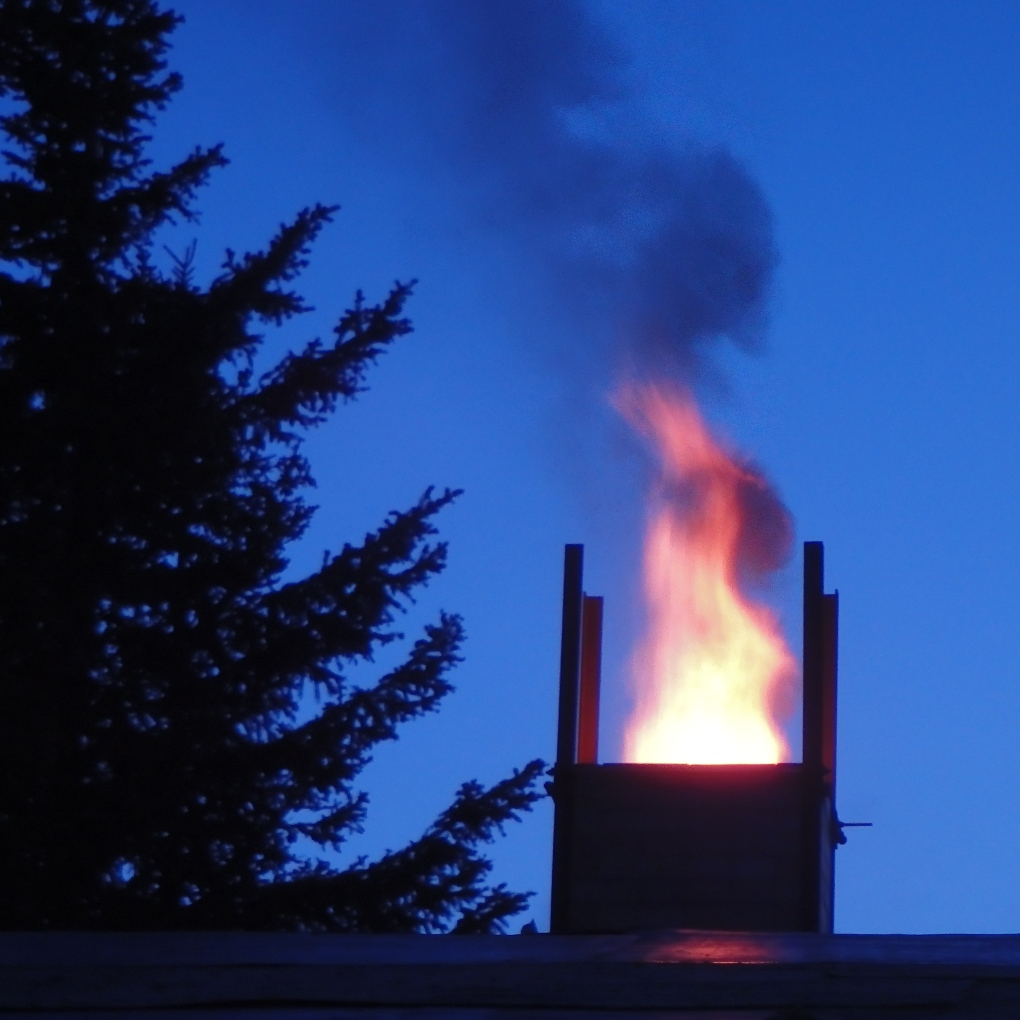 Flame comes out the chimney during firing to temperature of 2350 degrees F