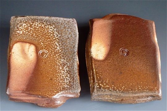 Natural ash glazed backs of small desert plates pictured above